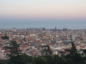 """The view from """"our"""" park, with Sagrada Familia on the right side. That's the sea in the background, where the building stop"""