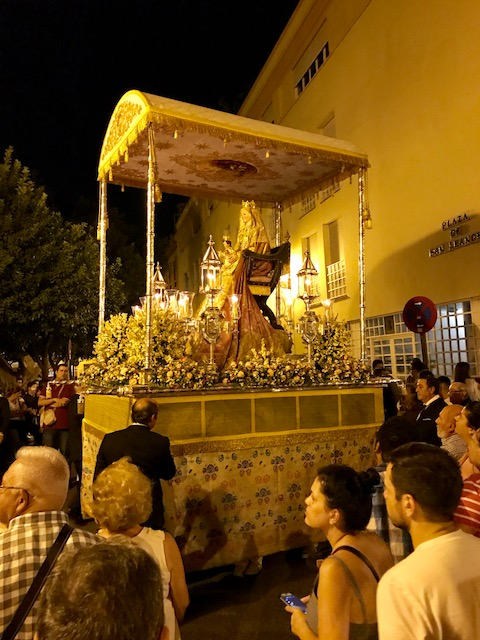 The Virgin Mary on a float in a parade that was circling Plaza de San Leandro